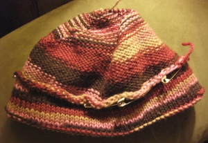 brim folded and safety pinned