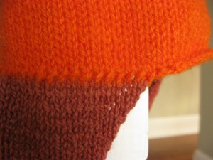 Detail of earflap on Jayne's hat