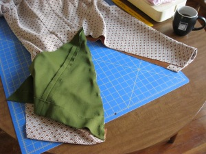 Sewing the opposite print triangle into each dress.