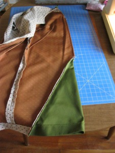 Seam sewn up the front of the brown dress.